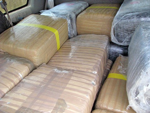 20 bundles of shrink wrapped marijuana weighing 457 pounds was found in the Suburban.