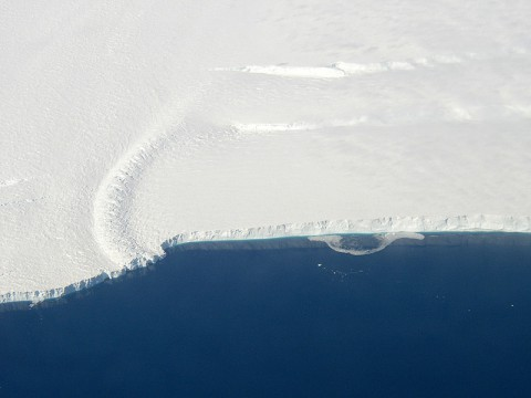 This photo shows the ice front of the ice shelf in front of Pine Island Glacier, a major glacier system of West Antarctica. The image was taken during the NASA/Centro de Estudios Cientificos, Chile (CECS) Antarctic campaign of Fall 2002. (Image credit: NASA/JPL-Caltech/UC Irvine)