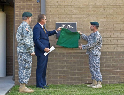 Col. Scott Brower, commander of the 5th Special Forces Group (Airborne), and Lt. Col. Andrew Hanson, commander of 1st Battalion, 5th SFG (A), join Bartley Williams, son of Maj. Charles Q. Williams, a Medal of Honor recipient and former member of the 5th SFG, in unveiling a plaque June 5, during a ceremony naming the battalion's operations complex as Williams Hall. (Photo by Staff Sgt. Barbara Ospina)