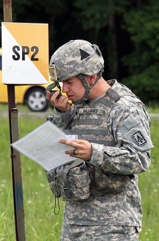 "Spc. Cecil Williams, an air defense battle management system operator for Battery A, 2nd Battalion, 44th Air Defense Artillery Regiment, 101st Sustainment Brigade, 101st Airborne Division (Air Assault), finds the next point with his compass during a land navigation course, June 19, at Fort Campbell. This is the fifth of seven events for ""Strike Fear Week"". (U.S. Army photo by Sgt. Leejay Lockhart, 101st Sustainment Brigade Public Affairs)"