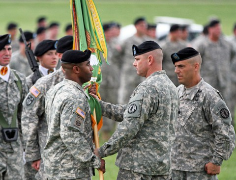 Col. Robert Dillon, commander of the 89th Military Police Brigade, passes the 716th Military Police Battalion's colors to Lt. Col. Leevaine Williams Jr., incoming commander of the 716th MP Battalion, June 28 at Fort Campbell, Ky. The 716th MP Battalion is the most decorated military police battalion in the U.S. Army. (U.S. Army photo by Sgt. Leejay Lockhart, 101st Sustainment Brigade Public Affairs)