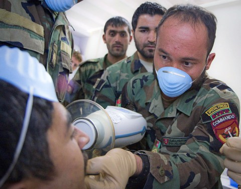 An Afghan soldier with the 2nd Commando Battalion, 203rd Corps, Afghan National Army, utilizes a NOMAD portable x-ray as other commandos observe during a basic dental class at Forward Operating Base Thunder in Paktia province, Afghanistan, July 22, 2013. (U.S. Army photo by Sgt. Justin A. Moeller/Released)