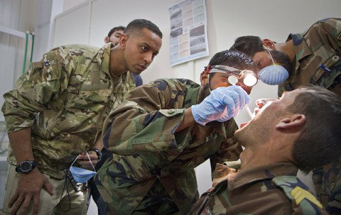 U.S. Army Capt. Abby Raymond, a brigade dentist with the 4th Brigade Combat Team, 101st Airborne Division (Air Assault), observes an Afghan medic with the 2nd Commando Battalion, 203rd Corps, Afghan National Army, as he performs an oral exam on a fellow commando during a basic dental class at Forward Operating Base Thunder in Paktia province, Afghanistan, July 22, 2013. (U.S. Army photo by Sgt. Justin A. Moeller/Released)