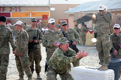 U.S. Army Capt. John Banaghan, a lawyer with 2-10 Security Forces Assistance Brigades legal team, attempts to catch a poorly thrown water balloon during the water balloon toss event at Forward Operating Base Sharana, Afghanistan, July 7th, 2013. Soldiers and civilians assigned to the post celebrated Independence Day with carnival games, a barbecue and music. (U.S. Army photo by 1st Lt. Justin Brooks, 2nd Battalion, 15th Field Artillery Regiment)