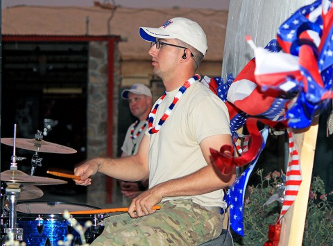 "U.S. Army Spc. Stephen Thacker, drummer for the 101st Airborne Division band ""Ambush"" drums out a groovy beat to a Radio Head song, at Forward Operating Base Sharana, Afghanistan, July 7th, 2013. Soldiers and civilians assigned to the post celebrated Independence Day with carnival games, a barbecue and music. (U.S. Army photo by 1st Lt. Justin Brooks, 2nd Battalion, 15th Field Artillery Regiment)"