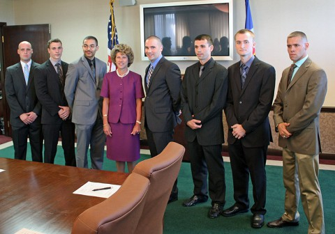 Clarksville Mayor Kim McMillian with the new officers at City Hall.