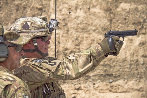 "U.S. Army Spc. Sean C. Poole, an infantryman with 2nd Battalion, 506th Infantry Regiment, 4th Brigade Combat Team ""Currahee"", 101st Airborne Division (Air Assault), fires an M9 at a target while competing for Soldier of the Quarter at forward operating base Salerno, Afghanistan, July 14, 2013. (U.S. Army photo by Sgt. Justin A. Moeller, 4th Brigade Combat Team Public Affairs)"