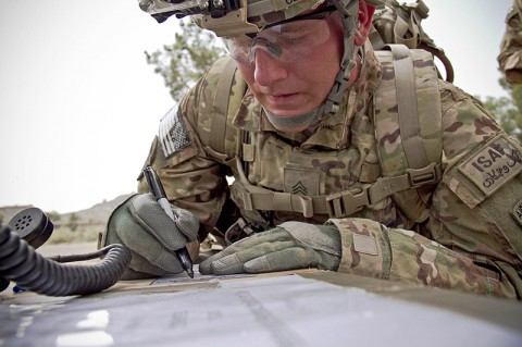 "U.S. Army Sgt. Alexander Cerney, an infantryman with 4th Brigade Special Troops Battalion, 4th Brigade Combat Team ""Currahee"", 101st Airborne Division (Air Assault), participating in the Noncommissioned Officer of the Quarter contest, writes down information for a 9-line medical evacuation at forward operating base Salerno, Afghanistan, July 14, 2013. (U.S. Army photo by Sgt. Justin A. Moeller, 4th Brigade Combat Team Public Affairs)"