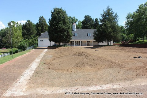 Dunbar Cave State Park prepares plaza area for new Butterfly Garden.