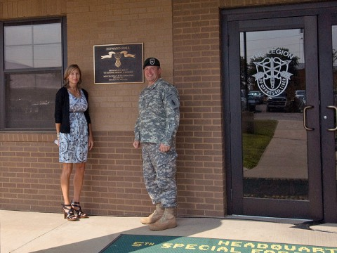 Colonel Scott Brower, commander of the 5th Special Forces Group (Airborne), is joined by Mrs. Melissa Gentsch, daughter of retired Army Col. Robert Howard, following the dedication of the 5th SFG (A) headquarters building in honor of Col. Howard July 3rd, 2013, at Fort Campbell, KY. (Photo courtesy of Staff Sgt. Barbara Ospina)