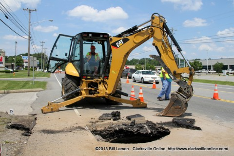 Tennessee Department of Transportation crew working on an emergency patch over a hole on Madison Street.