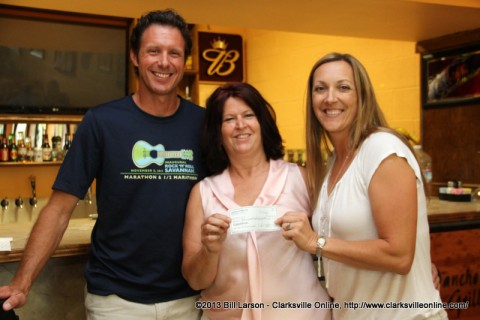 Clarksville Running Club President Mike Heiser; Project F.U.E.L. founder Denise Skidmore; and Marlene Deem, Race Director for the Wilma Rudolph 5k-10k Run after the check presentation