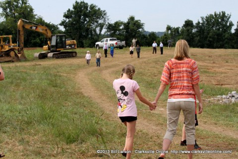 Guests take a look at the new park site after the groundbreaking