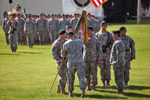 Col. John Brennan accepts the 5th Special Forces Group (Airborne) Colors from Brig. Gen. Christopher Haas, commander of the U.S. Army Special Forces Command, as he assumes command from Col. Scott Brower during a ceremony at Fort Campbell, KY, July 12th, 2013. (Photo courtesy of Spec. Seth Plagenza)
