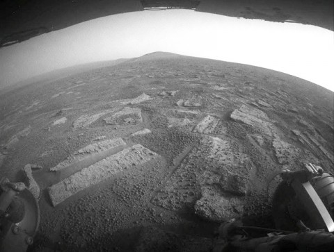 "This view shows the terrain that NASA's Mars Exploration Rover Opportunity is crossing in a flat area called ""Botany Bay"" on the way toward ""Solander Point,"" which is visible on the horizon. (Image credit: NASA/JPL-Caltech)"