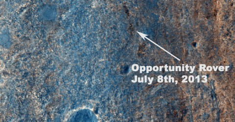 """This image taken by the High Resolution Imaging Science Experiment (HiRISE) camera on NASA's Mars Reconnaissance Orbiter on July 8, 2013, captures NASA's Mars Exploration Rover Opportunity traversing south (at the end of the white arrow) to new science targets and a winter haven at """"Solander Point,"""" another portion of the Endeavour rim. (Image credit: NASA/JPL-Caltech/Univ. of Arizona)"""