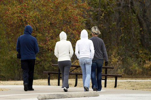 People walking in a park. (American Heart Association)