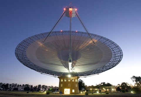 This image shows the Parkes telescope in Australia, part of the Commonwealth Scientific and Industrial Research Organization. Researchers, including a team member from NASA's Jet Propulsion Laboratory in Pasadena, used the telescope to detect the first population of radio bursts known to originate from beyond our galaxy. (Image courtesy Shaun Amy)