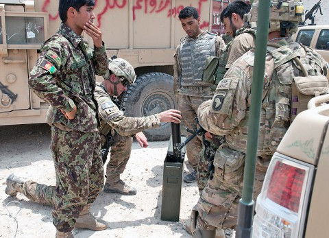 A U.S. Army Soldier with Security Forces Advisory and Assistance Team Blackhorse, 1st Battalion, 327th Infantry Regiment, 1st Brigade Combat Team, 101st Airborne Division, examines a container of mortar rounds at former Forward Operating Base Connolly, Nangarhar Province, Afghanistan, July 7, 2013.  (U.S. Army photo by Sgt. Margaret Taylor, 129th Mobile Public Affairs Detachment)
