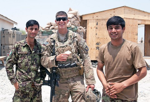 A U.S. Army Soldier with Security Forces Advisory and Assistance Team Blackhorse, 1st Battalion, 327th Infantry Regiment, 1st Brigade Combat Team, 101st Airborne Division, poses with two Afghan National Army soldiers at former Forward Operating Base Connolly, Nangarhar Province, Afghanistan, July 7, 2013. (U.S. Army photo by Sgt. Margaret Taylor, 129th Mobile Public Affairs Detachment)