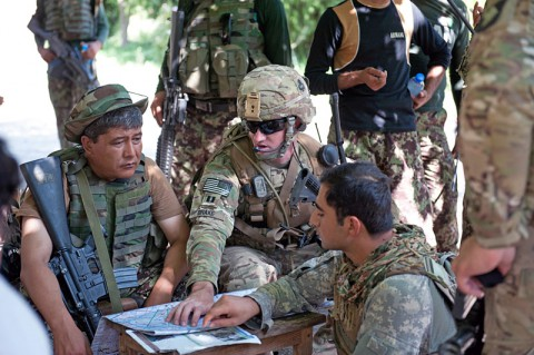 U.S. Army Capt. Nicholas Drake, commander, Security Forces Advisory and Assistance Team Archangel, 1st Brigade Combat Team, 101st Airborne Division, of Calabasas, Calif., confers with Afghan National Army Lt. Col. Mohammad Bashir, commander, 2nd Kandak, 4th Brigade, on the outskirts of the village of Takiya Khana, Bati Kot district, Nangarhar Province, Afghanistan, June 15, 2013. (U.S. Army photo by Sgt. Margaret Taylor, 129th Mobile Public Affairs Detachment)