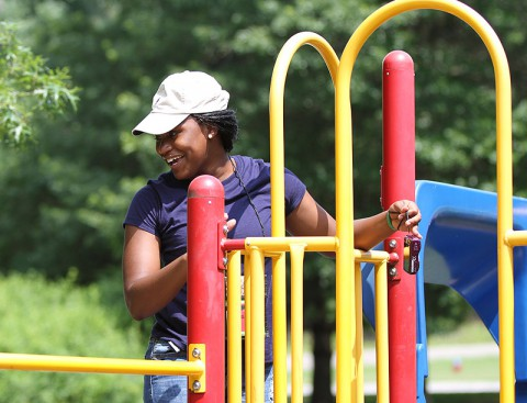 Volunteer camp counselor Pfc. Raven Clark, Headquarters and Headquarters Detachment, 129th Combat Sustainment Support Battalion, 101st Sustainment Brigade, 101st Airborne Division (Air Assault), keeps an eye on campers playing on the playground, July 10th, at Fort Campbell, KY. Volunteers from the brigade spent the entire week at Camp SOS with the children; however, they had to leave their cell phones and cars behind. (U.S. Army photo by Sgt. Leejay Lockhart, 101st Sustainment Brigade Public Affairs)