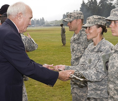 APSU ROTC Cadet Cynthia Stinnett receives the Association of the U.S. Army (AUSA) saber as distinguished honor graduate of the 8th Regiment from retired Col. Carroll Dickson, an AUSA chapter president. (Photo provided)