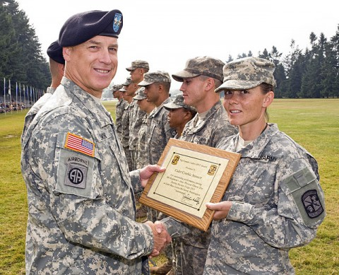 Maj. Gen. Jefforey Smith, commander of the U.S. Army Cadet Command, presents Cadet Cynthia Stinnett with a plaque for earning the top Army physical fitness test score. (Photo provided)