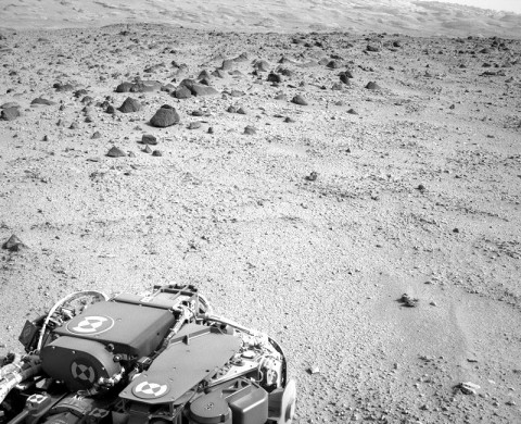 Lower slopes of Mount Sharp appear at the top of this image taken by the right Navigation Camera (Navcam) of NASA's Mars rover Curiosity at the end of a drive of about 135 feet (41 meters) during the 329th Martian day, or sol, of the rover's work on Mars (July 9th, 2013). (Credit: NASA/JPL-Caltech)