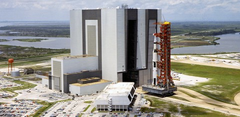 The Apollo 11 rocket towers over the Kennedy Space Center's crawlerway during the May 20th, 1969 rollout from the Vehicle Assembly Building to Launch Pad 39A. The Saturn V launched astronauts Neil Armstrong, Michael Collins and Buzz Aldrin on the first lunar landing mission wtih Armstrong and Aldrin walking on the moon on July 20th. 1969. (Image Credit: NASA)