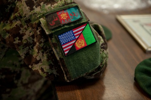 An Afghan National Army soldier from 2nd Kandak, 4th Brigade, shows off a dual flag patch he received from American Soldiers from Security Forces Advisory and Assistance Team Archangel. The patch represents the ongoing partnership between U.S. and Afghan forces.(Sgt. Margaret Taylor/U.S. Army)