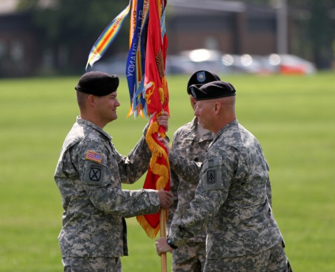 Col. Edward O'Neill, commander of the 108th Air Defense Artillery Brigade, passes the battalion colors to Lt. Col. Timothy Shaffer, incoming commander of the 2nd Battalion, 44th Air Defense Artillery Regiment. (Sgt. Leejay Lockhart/U.S. Army)