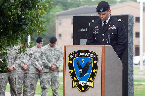 Capt. Nathan White, chaplain, 5th Battalion, 101st Combat Aviation Brigade, 101st Airborne Division (Air Assault) delivers the invocation at the beginning of a ceremony where two trees were dedicated to fallen comrades at Fort Campbell, KY, Aug. 9, 2013. (U.S. Army photo by Sgt. Duncan Brennan, 101st CAB Public Affairs)