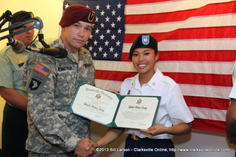 CW2 Roy Swearengin the re-enlistment officer with Spc. Ilka Luna after her re-enlistment in the U.S. Army