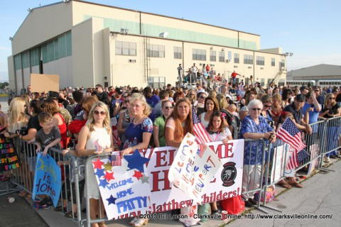 Families wait for the airplane carrying their soldier's home to land