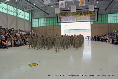 The soldiers march into the hanger