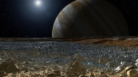 This artist's concept shows a simulated view from the surface of Jupiter's moon Europa. Europa's potentially rough, icy surface, tinged with reddish areas that scientists hope to learn more about, can be seen in the foreground. The giant planet Jupiter looms over the horizon. (Image credit: NASA/JPL-Caltech)