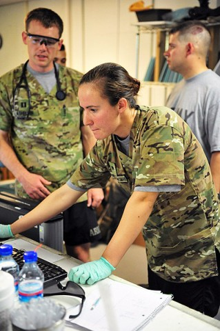 "U.S. Army Spc. Megan Dalton, radiology specialist with Company C, 801st Brigade Support Battalion, 4th Brigade Combat Team ""Currahee,"" 101st Airborne Division (Air Assault), checks a computer screen at the Combat Support Hospital on Forward Operating Base Salerno, Afghanistan, July 14, 2013. (U.S. Army photo by Maj. Kamil Sztalkoper, 4th Brigade Combat Team Public Affairs)"