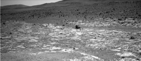 "This view from NASA's Mars Exploration Rover Opportunity shows an area where a pale-toned geological unit called the ""Burns Foundation,"" in the foreground, abuts a different geological unit. The darker unit, believed to be older, marks the edge of ""Solander Point,"" a raised segment of the western rim of Endeavour Crater. (Image credit: NASA/JPL-Caltech)"