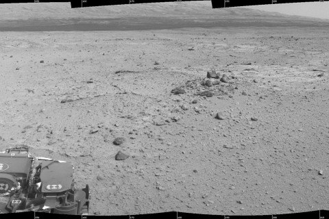 This mosaic of images from the Navigation Camera (Navcam) on NASA's Mars rover Curiosity shows the scene from the rover's position on the 376th Martian day, or sol, of the mission (Aug. 27, 2013). The images were taken right after Curiosity completed the first drive during which it used autonomous navigation on unknown ground. (Credit: NASA/JPL-Caltech)