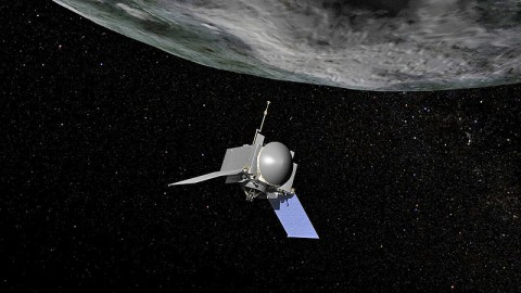 This is an artist's concept of NASA's OSIRIS-REx spacecraft preparing to take a sample from asteroid Bennu. (Image Credit: NASA/Goddard/Chris Meaney)