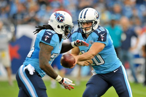Tennessee Titans quarterback Jake Locker (10) hands off to Titans running back Chris Johnson (28) against the Washington Redskins during the first half at LP Field. (Jim Brown/USA TODAY Sports)