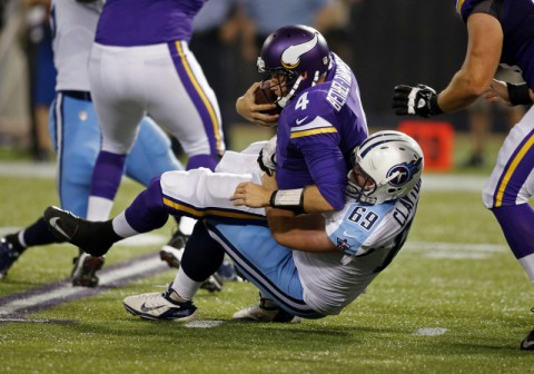 Tennessee Titans defensive tackle Zach Clayton (69) sacks Minnesota Vikings quarterback McLeod Bethel-Thompson (4) in the third quarter at Mall of America Field at H.H.H. Metrodome. Vikings win 24-23 on August 29th, 2013. (Bruce Kluckhohn - USA TODAY Sports)