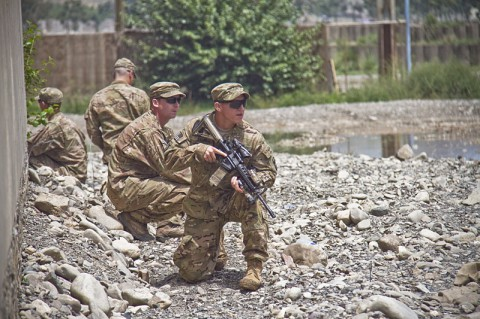 Soldiers with India Company, 2nd Battalion, 506th Infantry Regiment, 4th Brigade Combat Team, 101st Airborne Division (Air Assault), show members of the Afghan Uniformed Police on how to pull security during a tactical training class Aug. 15, 2013 at Forward Operating Base Salerno, Afghanistan. (U.S. Army photo by Sgt. Justin A. Moeller, 4th Brigade Combat Team Public Affairs)