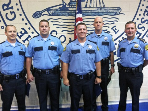 The graduates from left, Deputies Eric Trout, Patrick Turner, Christopher Owens, and Robert Parker. Montogmery County Sheriff John Fuson is on the right.