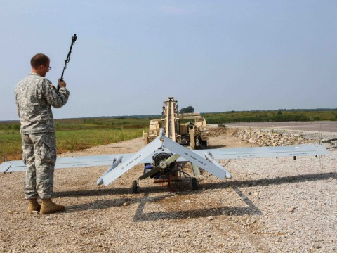 """Spc. Thomas Olsen, a Tactical Unmanned Aerial System maintainer assigned to the TUAS Platoon, Company B, 3rd Special Troops Battalion, 3rd Brigade Combat Team """"Rakkasans,"""" 101st Airborne Division (Air Assault), calls in another systems check before loading the Shadow Unmanned Aerial System on the launcher at Fort Campbell, Ky., Sept. 9, 2013. Olsen and the rest of his platoon spent three weeks in the field to advance their skills and to increase their readiness level so they are ready to assist the brigade on future missions. (Spc. Brian Smith-Dutton/U.S.Army)"""