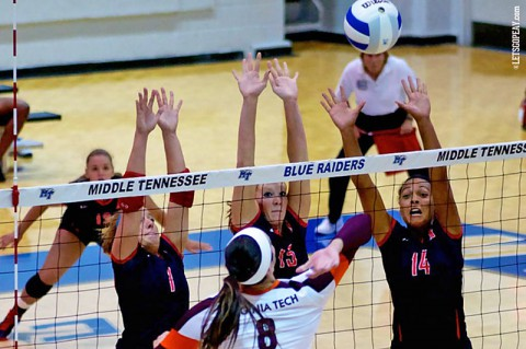 Austin Peay's Cami Fields, Hillary Plybon and Jada Stotts go up for a block against Virginia Tech's Samantha Gostling, Friday, in the opening match of the MT Invitational. (APSU Sports Information)