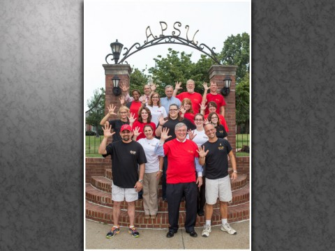"""APSU President Tim Hall (center) joins members of APSU's Phi Alpha Theta History Honor Society in celebrating the club's fifth """"Best Chapter of the Year"""" award. (Photo by Beth Liggett/APSU)"""