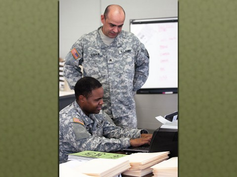 Sgt. Jose Rivera assists Pvt. 1st Class Armando Luna, both automated logistical specialist with Echo Company, 1st Battalion, 506th Infantry Regiment, 4th Brigade Combat Team, 101st Airborne Division, with entering inventory data into a computer program. (Sgt. David Cox, 4th Brigade Combat Team Public Affairs)