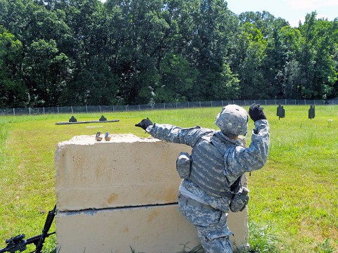 Spc. Kyle Dion, an Avenger crew member with Battery C, 2nd Battalion, 44th Air Defense Artillery Regiment, 101st Sustainment Brigade, 101st Airborne Division (Air Assault), throws a M69 practice grenade during a grenade qualification range Sept. 3, 2013, at Fort Campbell, Ky. (U.S. Army photo by 1st Lt. Joseph Riedel, 2nd Battalion, 44th Air Defense Artillery Regiment)